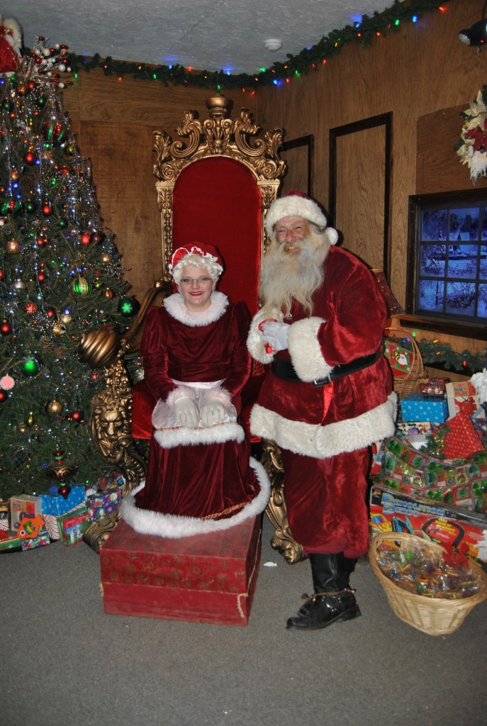 Mr. and Mrs. Claus were very popular that night and got a moment to rest between family portraits.
